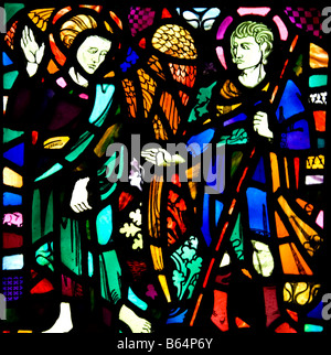 St Samson as a young Knight With an angel Depicted in the west wall window of the Nave of St Illtyd's Church Caldey - Stock Photo