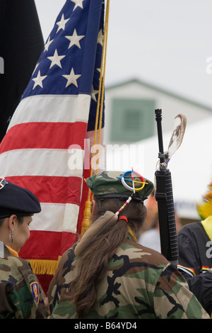 Native Americans at the Healing Horse Spirit PowWow in Maryland carry an American flag and gun decorated with a - Stock Photo