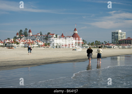 People walk on the beach in front of the Hotel del Coronado Coronado San Diego California no MRs - Stock Photo