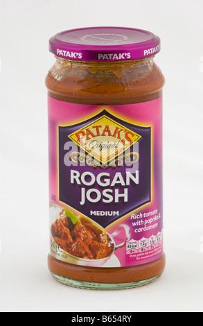 Jar of Pataks Rogan Josh medium curry cooking sauce sold in the UK - Stock Photo