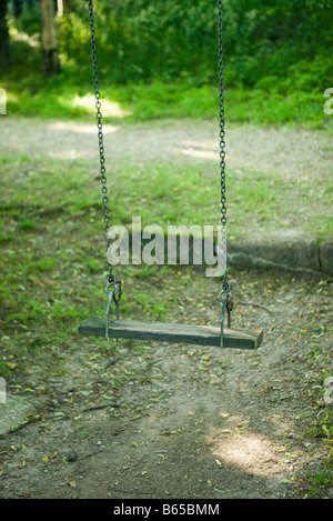Swing with wooden sweet - Stock Photo