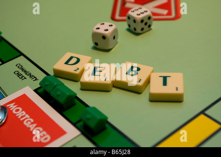 mortgaged monopoly houses, debt scrabble - Stock Photo