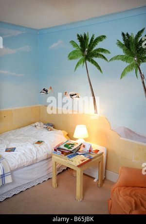 A CHILDS NURSERY WITH HAND PAINTED WALL MURALS UK Stock Photo