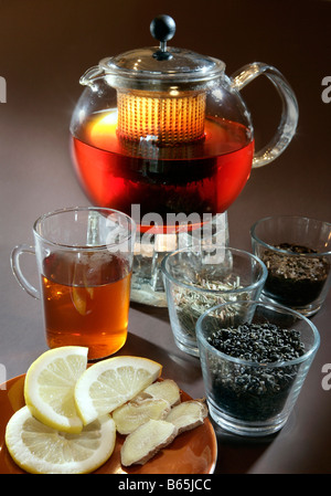 Tea still life with rooibos tea & teacup, teapot, lemon and ginger - Stock Photo
