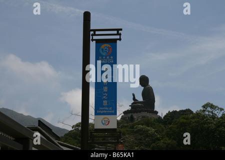 Ngong Ping cable car sign and Giant Buddha Lantau Island Hong Kong  April 2008 - Stock Photo