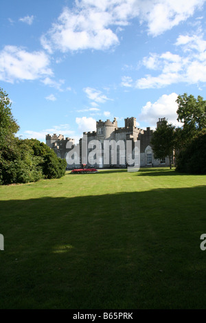An imposing castle near Skerries, County Dublin, Ireland nestling in its  grounds viewed from its green lawn - Stock Photo
