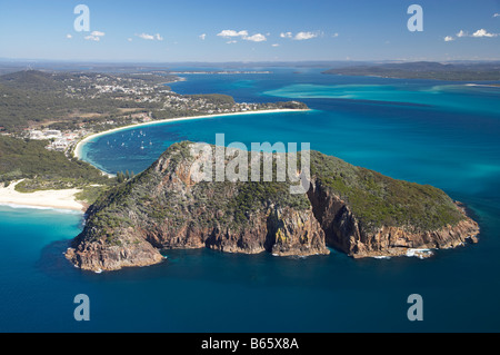 Tomaree Head Zenith Beach left Shoal Bay distance at entrance to Port Stephens New South Wales Australia aerial - Stock Photo
