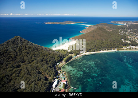 Tomaree Head Shoal Bay right and Zenith Beach left at entrance to Port Stephens New South Wales Australia aerial - Stock Photo