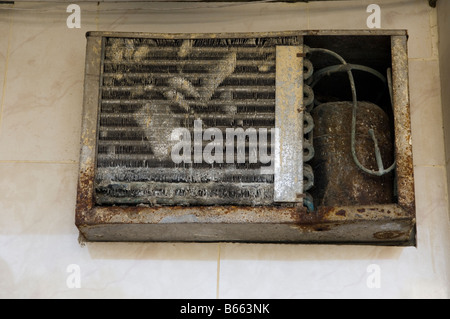Damaged old air condition - Stock Photo