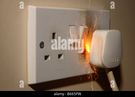 A fire in a 13A 240V electrical mains plug and socket. - Stock Photo