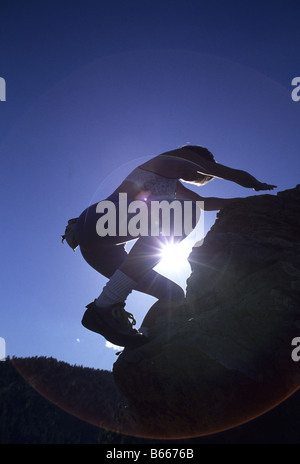 Woman rock climbing without equipment - Stock Photo