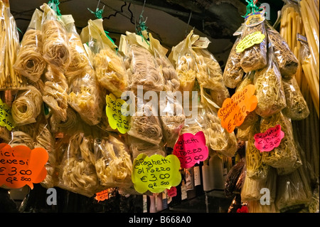 Bags of dried Italian pasta, from durum wheat, hanging in a shop in Naples' Centro Storico. Not introduced by Marco - Stock Photo