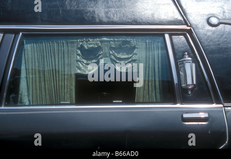 Funeral car, hearse outside an undertaker in Panama City - Stock Photo