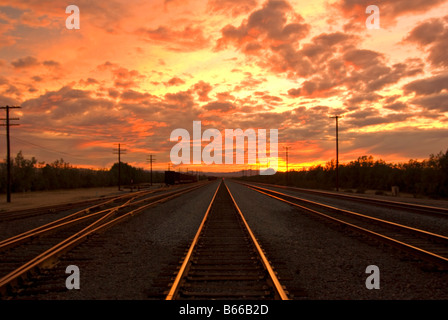 Sunset on railroad tracks in Kelso, California - Stock Photo
