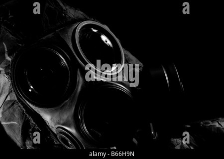 Soldier in respirator and protective suit - Stock Photo