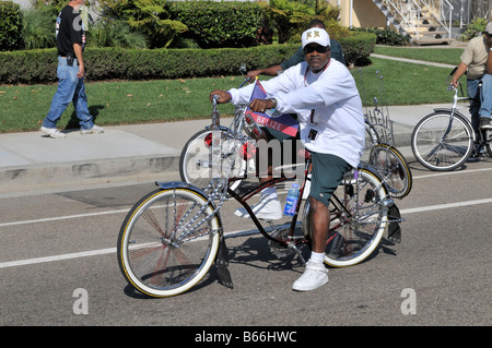 Young adult African American man proudly showing off his fantastically imaginative bike - Stock Photo