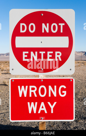 DoNot Enter / Wrong Way sign on I15 in the Mojave Desert, California - Stock Photo