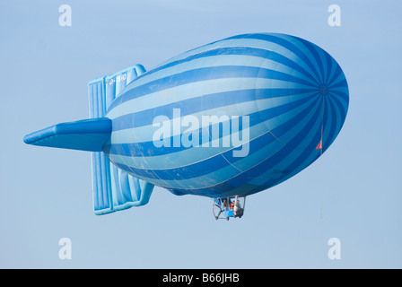 Hot air balloon with German registration shaped as an old fashioned airship - Stock Photo