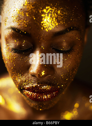 Young Woman Covered in Gold Leaf - Stock Photo