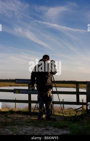 Birdwatching, or birding, birders, wildlife observation binoculars, scopes, optics, tripods at Southport, Merseyside - Stock Photo
