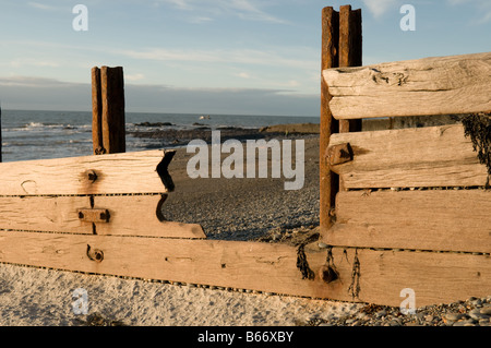 heavily eroded and storm damaged sea defences on Aberystwyth beach Wales UK in need of repair or replacement - Stock Photo
