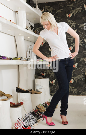 Woman trying on shoes in a store - Stock Photo