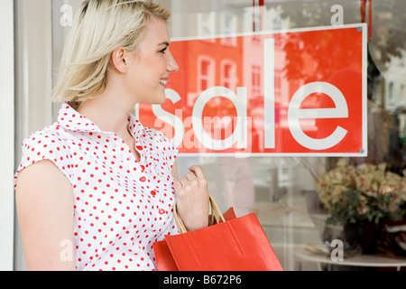 Woman looking at a shop sale