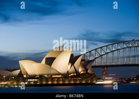 Sydney opera house and harbour bridge at night - Stock Photo