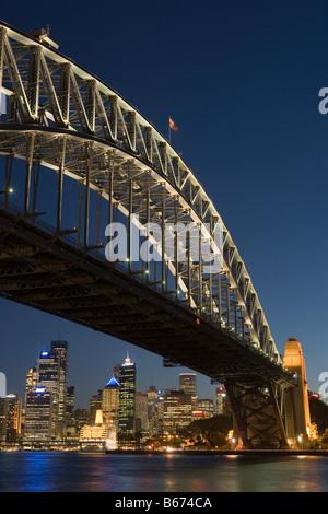 Sydney harbour bridge and skyline at nigh - Stock Photo