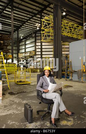 Businesswoman in warehouse - Stock Photo