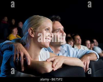 A couple watching a movie - Stock Photo