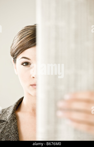 A woman reading the financial paper - Stock Photo