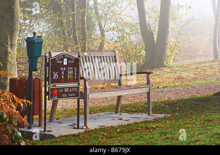 The bench at the tee on the 16th hole on the Monnow golf course in Usk South Wales - Stock Photo