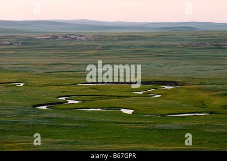 River flows through summer grasslands Xiwuzhumuqinqi Inner Mongolia China - Stock Photo