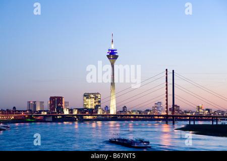 View arcoss river Rhine to Media Harbour and Rheinturm Tower in the evening, Dusseldorf, North Rhine-Westphalia, - Stock Photo