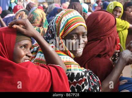 somalian women and children in refugee camp in Dadaab, at the border of Kenya and Somalia - Stock Photo