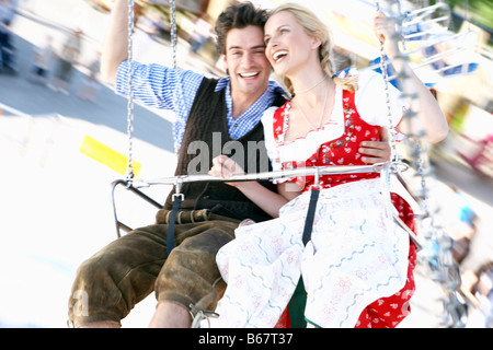 Couple in a chairoplane - Stock Photo