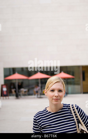 Woman standing in front of Museum of history and art, Luxembourg - Stock Photo