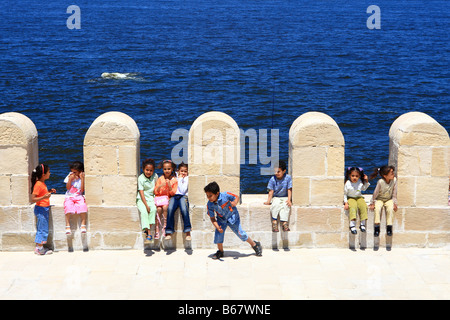 Egyptian children sitting in the loopholes at Qaitbey fort in Alexandria Egypt - Stock Photo