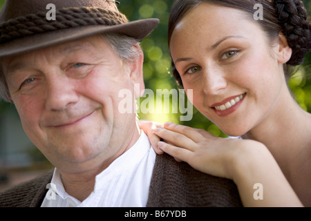 Mature man with young woman in beergarden near Lake Starnberg, Bavaria, Germany - Stock Photo
