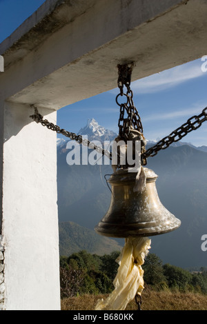 Fishtail Mountain and bell from Baraha Buddhist temple above Ghandruk village in the Annapurna range, Himalayas, - Stock Photo
