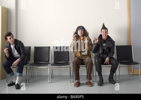 Punk, Hippy and Rebel in Waiting Area - Stock Photo