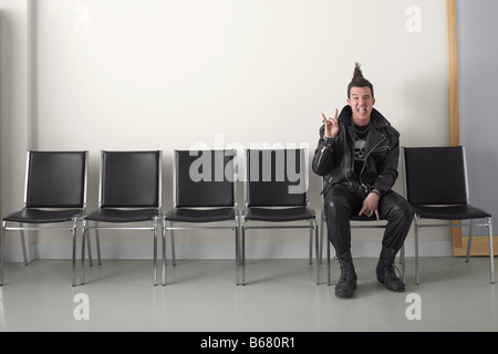 Punk in Waiting Area - Stock Photo