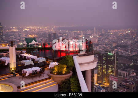 View over open air-bar Sirocco Sky Bar and Bangkok in the evening, State Tower, The Dome, Bangkok, Thailand - Stock Photo
