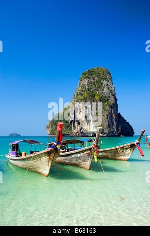 Anchored boats, chalk cliff in background, Phra Nang Beach, Laem Phra Nang, Railay, Krabi, Thailand, after the tsunami - Stock Photo