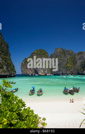 View over Maya Bay, a beautiful scenic lagoon, famous for the Hollywood film 'The Beach' with anchored boats, Ko - Stock Photo