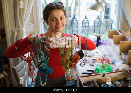 Craft Jeweller with Necklaces - Stock Photo