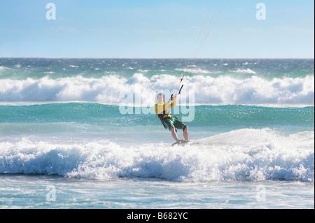 Man kitesurfing in heavy sea - Stock Photo