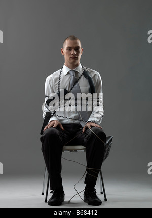 Businessman on a chair - Stock Photo