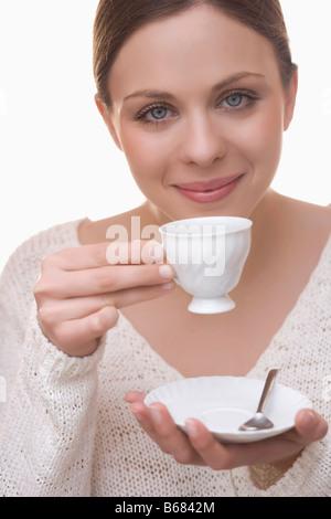 Woman Drinking Tea - Stock Photo